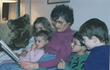 Reading a story to my four grandchildren
